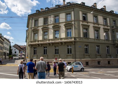 Basel / Switzerland - May 31 2019: A Viking Cruise Ship tour group walking through the streets of Basel, crossing the streets at St. Alban - Graben by the Munster Museum for Culture