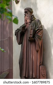 Basel / Switzerland - May 31 2019: German Scholar, Reformer and Protestant Clergyman Statue Johannes Oecolmampadius / Huszgen/ Munster 1526