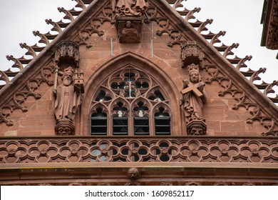 Basel / Switzerland - May 31 2019: Basel Munster Cathedral Pediment Statues On Left Heinrich II Holy Roman Emperor and On Right Wife, Empress Kunigunde