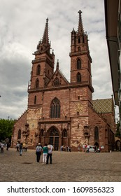 Basel / Switzerland - May 31 2019: A view of the Basel Cathedral or Minster or Munster from the Marketplatz or Market Square