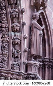 Basel / Switzerland - May 31, 2019: View of the West Facade of the Basel Minster or Munster Cathedral Showing Paradise Garden with Angels and Kinds, as well as the Seducer of Prince of the World