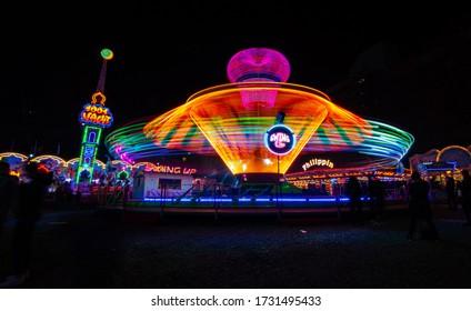 Basel, Switzerland - November 1, 2019 - Autumn Fair Rollercoaster with beautiful light trails in the dark