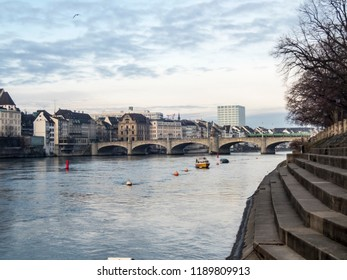 Basel, Switzerland, View over the river rhine to the old city of Basel, Switzerland. The middle bridge (Mittlere Bruecke) spans the river.