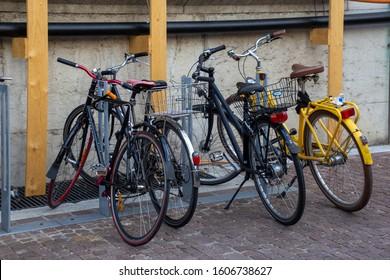 Basel/Switzerland - May 31 2019: Bicycles locked along a cobblestone street in Basel, Switzerland.