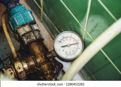Basement apartment house, cold water meter, piping.