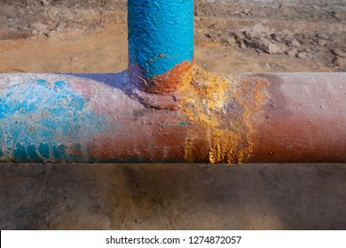 Basement apartment house. Old pipe - tee. Water supply pipe. Picture taken in Ukraine. Kiev region. Horizontal frame. Color image