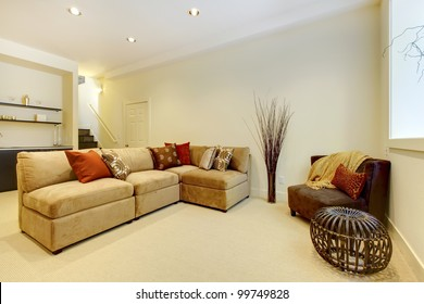 Basement area with living room and bathroom near bar.