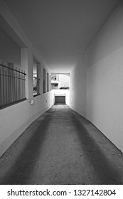 Basement Garage Driveway through an Appartment Building, on a Sunny Spring Morning - Black and White