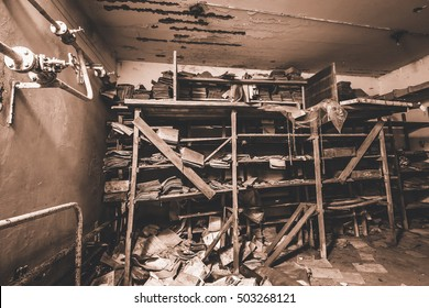 Basement of hidden secrets. Secret cellar. Abandoned bomb shelter of cold war times. Old books and documents. Low light conditions. Bunker of fear and nightmares. End of the world.