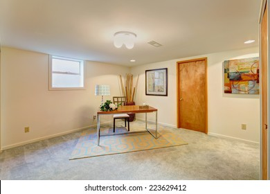 Basement light tone office room with desk and chair in the corner