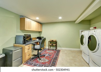 Basement room with combination of home office area and laundry appliances. Northwest, USA
