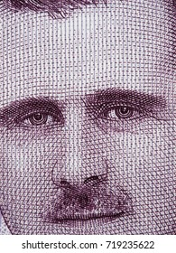 Bashar Assad face on Syria 2000 pounds banknote macro, Syrian money close up