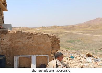 BASHIK FRONTLINE, KURDISTAN, IRAQ - 2015 JULY 25  - Kurdish (peshmerga) look out position at BASHIK (bashik) base 25km from ISIS controlled Mosul.