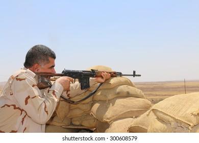 BASHIK FRONTLINE, KURDISTAN, IRAQ - 2015 JULY 25  - Kurdish (peshmerga) fighter at BASHIK (bashik) base 25km from ISIS controlled Mosul.