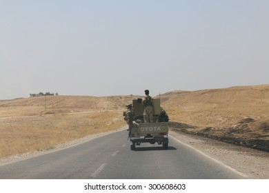 BASHIK FRONTLINE, KURDISTAN, IRAQ - 2015 JULY 25  - Kurdish (peshmerga) truck driving down road at BASHIK (bashik) base 25km from ISIS controlled Mosul.