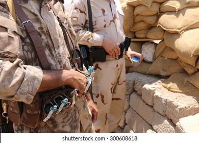 BASHIK FRONTLINE, KURDISTAN, IRAQ - 2015 JULY 25  - Two unidentified kurdish (peshmerga) militia at BASHIK (bashik) base 25km from ISIS controlled Mosul.