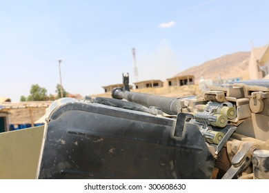 BASHIK FRONTLINE, KURDISTAN, IRAQ - 2015 JULY 25  - A machine gun mounted on a Kurdish (peshmerga) truck at BASHIK (bashik) base 25km from ISIS controlled Mosul.