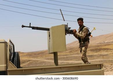 BASHIK FRONTLINE, KURDISTAN, IRAQ - 2015 JULY 25  - Unidentified kurdish (peshmerga) fighter in truck at BASHIK (bashik) base 25km from ISIS controlled Mosul.