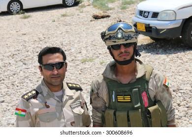 BASHIK FRONTLINE, KURDISTAN, IRAQ - 2015 JULY 25  - Two unidentified kurdish (peshmerga) fighters at BASHIK (bashik) base 25km from ISIS controlled Mosul.