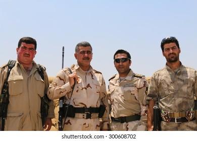 BASHIK FRONTLINE, KURDISTAN, IRAQ - 2015 JULY 25  - Unidentified kurdish (peshmerga) fighters at BASHIK (bashik) base 25km from ISIS controlled Mosul.