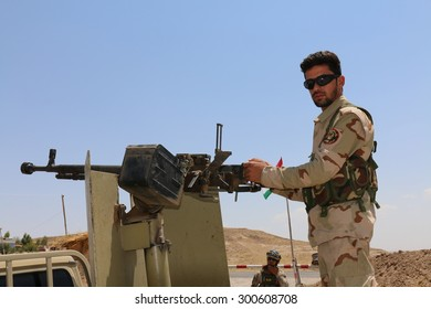 BASHIK FRONTLINE, KURDISTAN, IRAQ - 2015 JULY 25  - Unidentified kurdish (peshmerga) fighter in back of truck at BASHIK (bashik) base 25km from ISIS controlled Mosul.