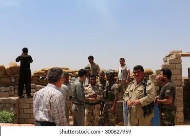 BASHIK FRONTLINE, KURDISTAN, IRAQ - 2015 JULY 25  - Kurdish (peshmerga) fighters  at BASHIK (bashik) base 25km from ISIS controlled Mosul.