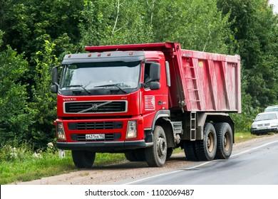 Bashkortostan, Russia - August 20, 2011: Red dump truck Volvo FM12.400 at the interurban road.
