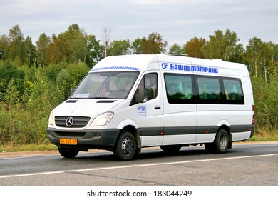 BASHKORTOSTAN, RUSSIA - AUGUST 29, 2008: White Mercedes-Benz Sprinter 515CDI interurban coach at the interurban road.