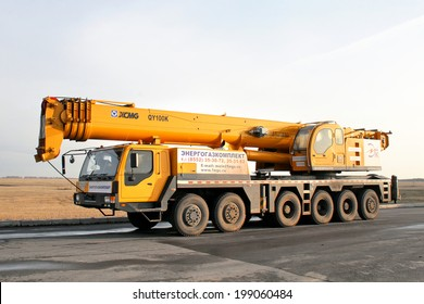 BASHKORTOSTAN, RUSSIA - DECEMBER 8, 2008: Yellow XOMG QY100K mobile crane at the interurban road.