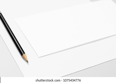 Basic blank stationery: paper, envelope, and pencil