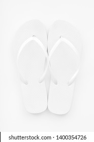 Basic blank, white flip flops on a white background. Near colorless image. Bright, high key exposure.