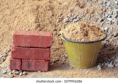 Basic building material such as sand, pebble, and bricks.