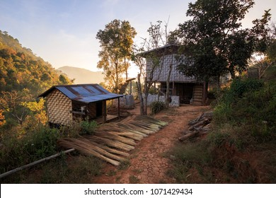 Basic home with no running water, electricity, or other modern conveniences outside a small village in the mountains in Shan State, Myanmar