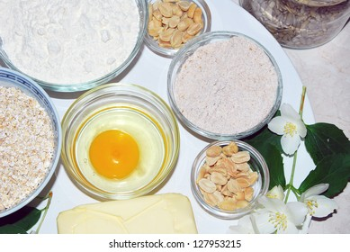 The basic ingredients for baking healthy cookies with nuts and raisins.