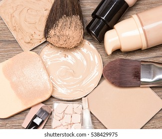 Basic make up products for flawless complexion: foundation, concealer, powder with cosmetic sponge and professional makeup brushes. Selective focus