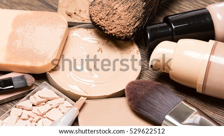 Basic makeup products for flawless complexion: foundation, concealer, powder, cosmetic sponge, professional makeup brushes. Selective focus