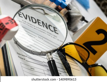 Basic research utensils with a evidence bag in Laboratory forensic equipment, conceptual image