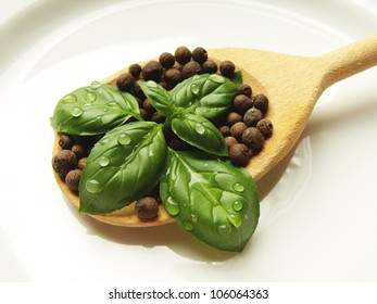 basil and allspice on spoon