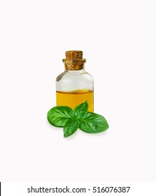 Basil essential oils in bottle isolated on white
