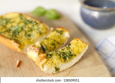 Basil garlic bread on a cutting board.