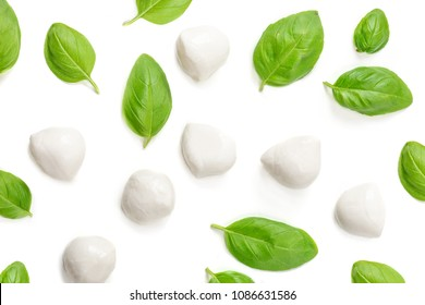 Basil and mozzarella. Food Ingredients pattern with mozarella cheese balls and fresh basil leaves, top view