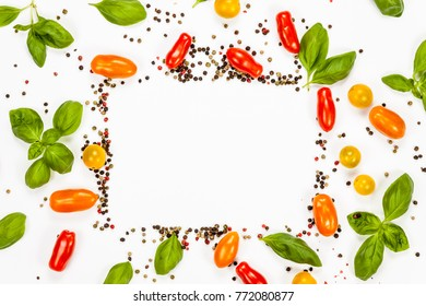 Basil, pepper and cherry tomatoes frame with rectangular copy space, on white background