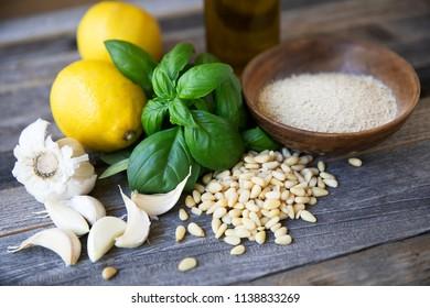 Basil, pine nuts, garlic, lemon, oil and nutritional yeast: ingredients for vegan pesto