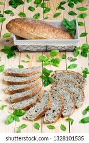 Basil sourdough bread on a wooden board