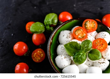 Basil, tomatoes and mozzarella for caprese salad, italian food and healthy vegetarian diet concept
