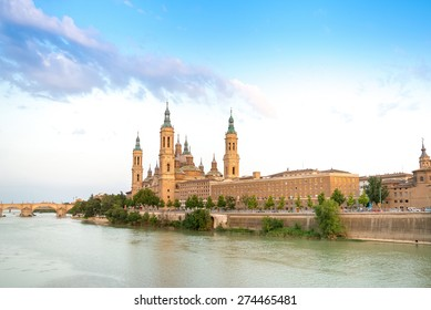 Basilica - Cathedral of Our Lady of Pillar and Ebro River in Zaragoza, Aragon, Spain. Pilar cathedral is Roman Catholic Church.