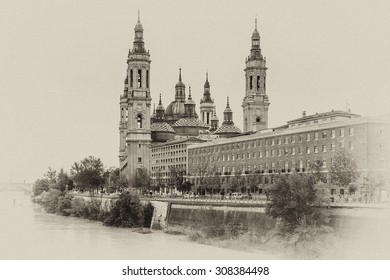Basilica - Cathedral of Our Lady of Pillar and Ebro River in Zaragoza, Aragon, Spain. Pilar cathedral is Roman Catholic Church. Antique vintage.