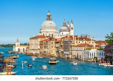 Basilica di Santa Maria della Salute on the Grand Canal in Venice, Italy. Water trip in Venice. Historical buildings and landscape of Venice. Scenic panorama of Venice in the sunlight.