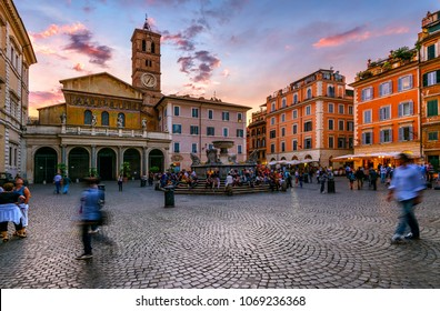 Basilica di Santa Maria in Trastevere and Piazza di Santa Maria in Trastevere at sunset, Rome, Italy. Trastevere is rione of Rome, on west bank of Tiber in Rome. Architecture and landmark of Rome
