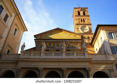 Basilica di Santa Maria in Trastevere ain Trastevere at sunset, Rome, Italy. Trastevere is rione of Rome, on west bank of Tiber in Rome. Architecture and landmark of Rome. .